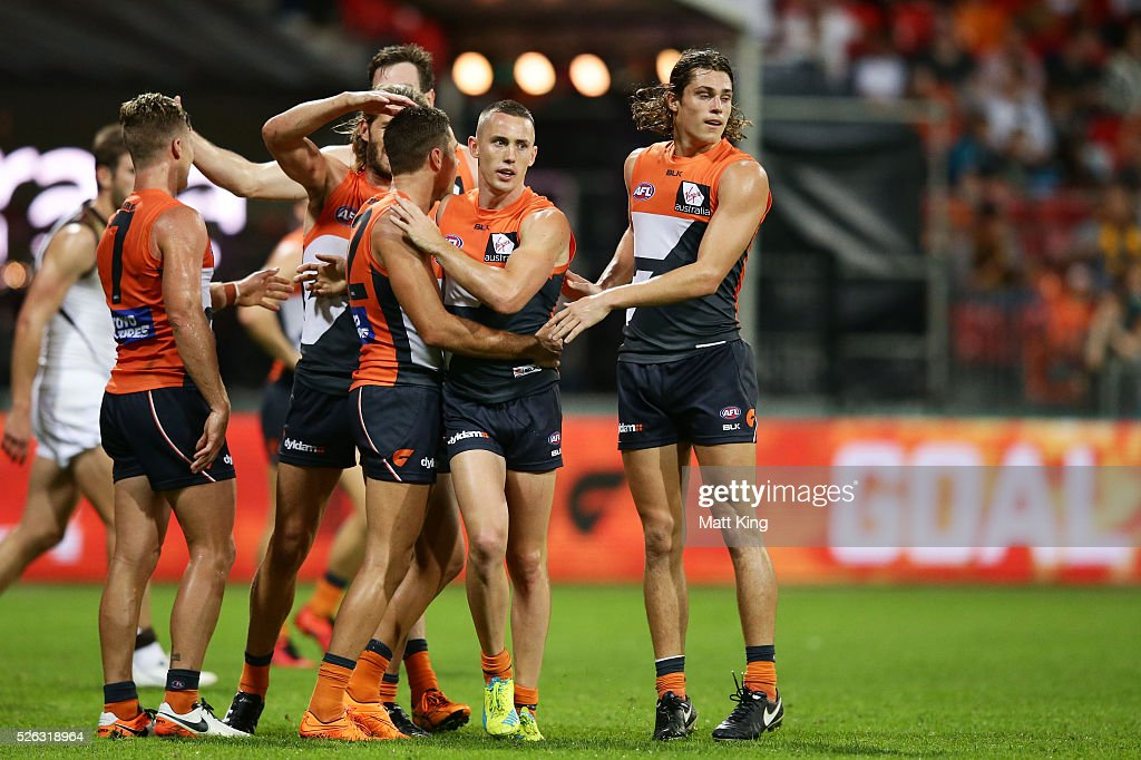 Tom Scully of the Giants celebrates with team mates after kicking a goal during the round six AFL match between the Greater Western Sydney Giants and the Hawthorn Hawks at Spotless Stadium on April 30, 2016 in Sydney, Australia.