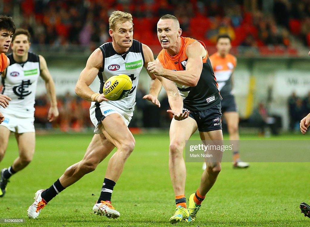 Tom Scully of the Giants hand balls during the round 14 AFL match between the Greater Western Sydney Giants and the Carlton Blues at Spotless Stadium on June 25, 2016 in Sydney, Australia.