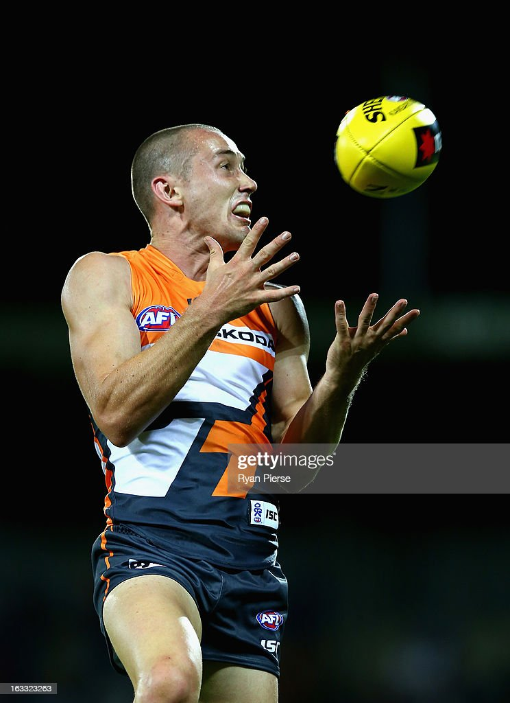 Tom Scully of the Giants marks during the round three of the NAB Cup AFL match between the Greater Western Sydney Giants and the Essendon Bombers at Manuka Oval on March 8, 2013 in Canberra, Australia.