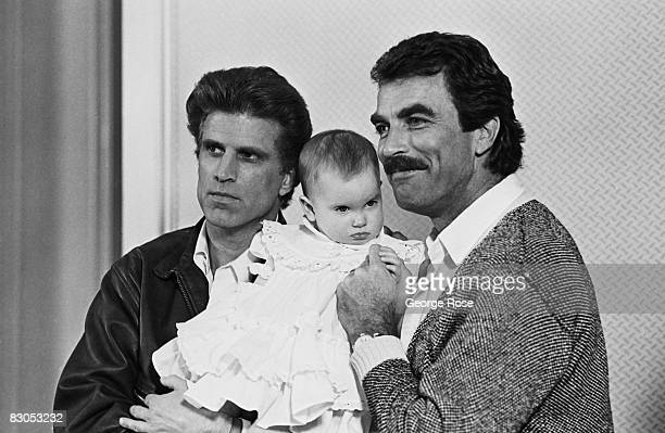 Tom Selleck and Ted Danson two of the stars of 'Three Men and A Baby' pose with a baby during a 1988 Beverly Hills California photo portrait session...