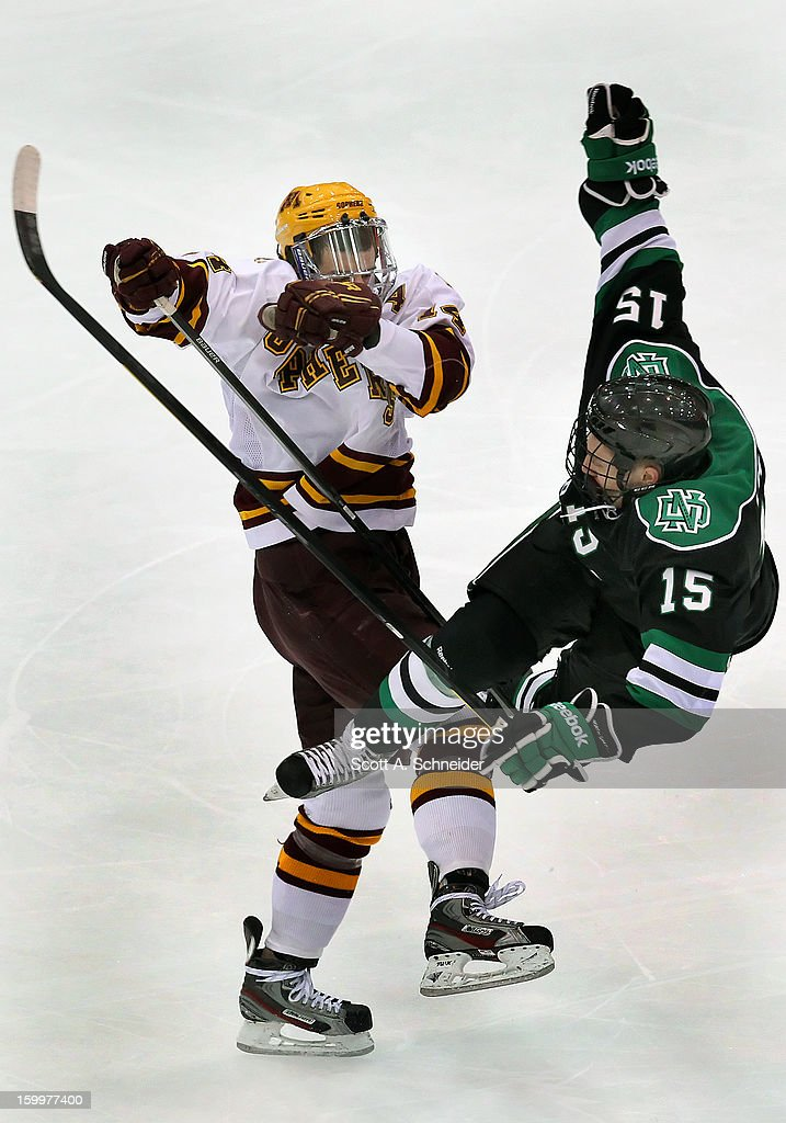 Tom Serratore #14 of Minnesota decks Michael Parks #15 of North Dakota January 19, 2013 at Mariucci Arena in Minneapolis, Minnesota.
