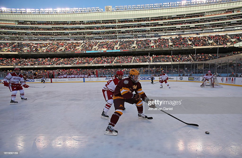 Tom Serratore #14 of the Minnesota Golden Gophers controls the puck next to Jefferson Dahl #14 of the Wisconsin Badgers during the Hockey City Classic at Soldier Field on February 17, 2013 in Chicago, Illinois.