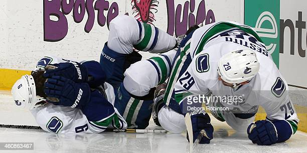 Tom Sestito and Zack Kassian of the Vancouver Canucks collide during the game against the Anaheim Ducks on January 5 2014 at Honda Center in Anaheim...