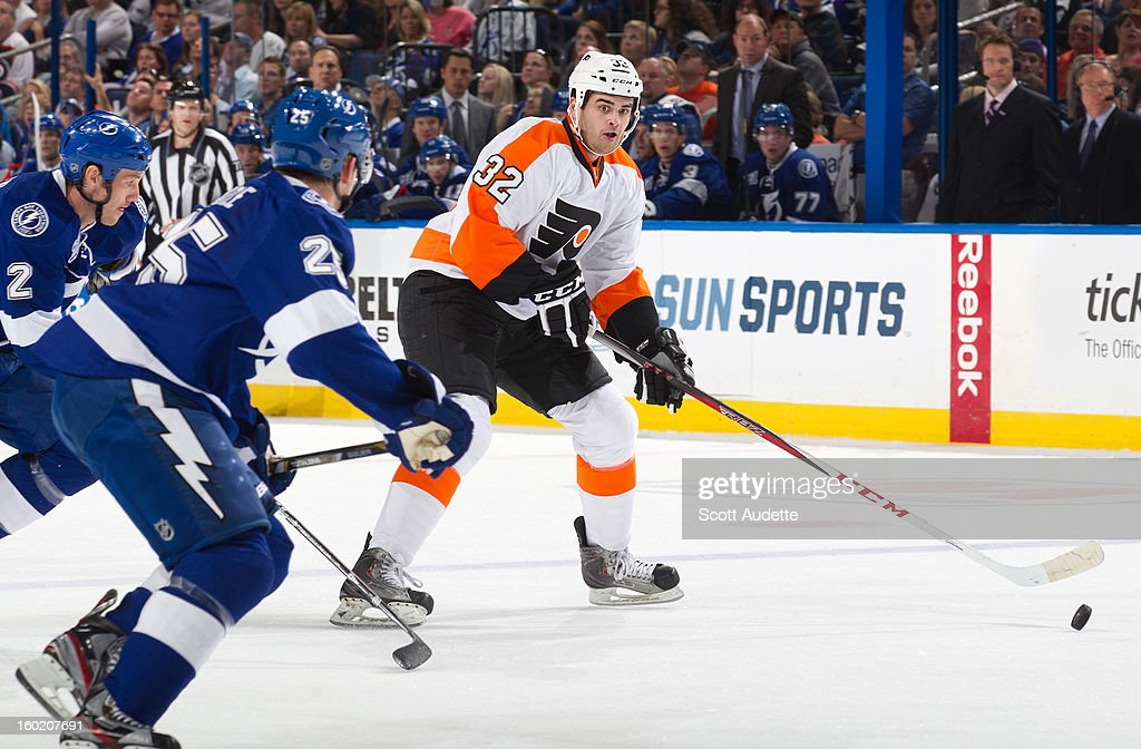 Tom Sestito #32 of the Philadelphia Flyers attempts to control the puck while getting pressured from <a gi-track='captionPersonalityLinkClicked' href=/galleries/search?phrase=Eric+Brewer&family=editorial&specificpeople=202144 ng-click='$event.stopPropagation()'>Eric Brewer</a> #2 and <a gi-track='captionPersonalityLinkClicked' href=/galleries/search?phrase=Matt+Carle&family=editorial&specificpeople=582495 ng-click='$event.stopPropagation()'>Matt Carle</a> #25 both of the Tampa Bay Lightning at the Tampa Bay Times Forum on January 27, 2013 in Tampa, Florida.