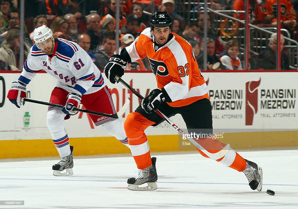 Tom Sestito #32 of the Philadelphia Flyers gets to the puck before <a gi-track='captionPersonalityLinkClicked' href=/galleries/search?phrase=Rick+Nash&family=editorial&specificpeople=202196 ng-click='$event.stopPropagation()'>Rick Nash</a> #61 of the New York Rangers on January 24, 2013 at the Wells Fargo Center in Philadelphia, Pennsylvania.