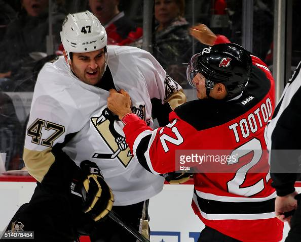 Tom Sestito of the Pittsburgh Penguins and Jordin Tootoo of the New Jersey Devils fight in the first period on March 6 2016 at Prudential Center in...