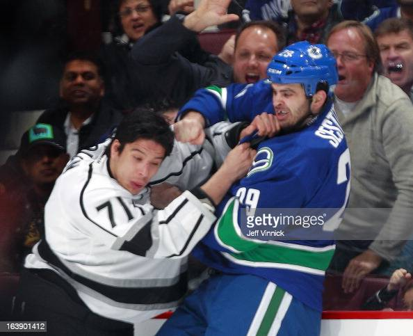 Tom Sestito of the Vancouver Canucks and Jordan Nolan of the Los Angeles Kings fight during their NHL game at Rogers Arena March 2 2013 in Vancouver...