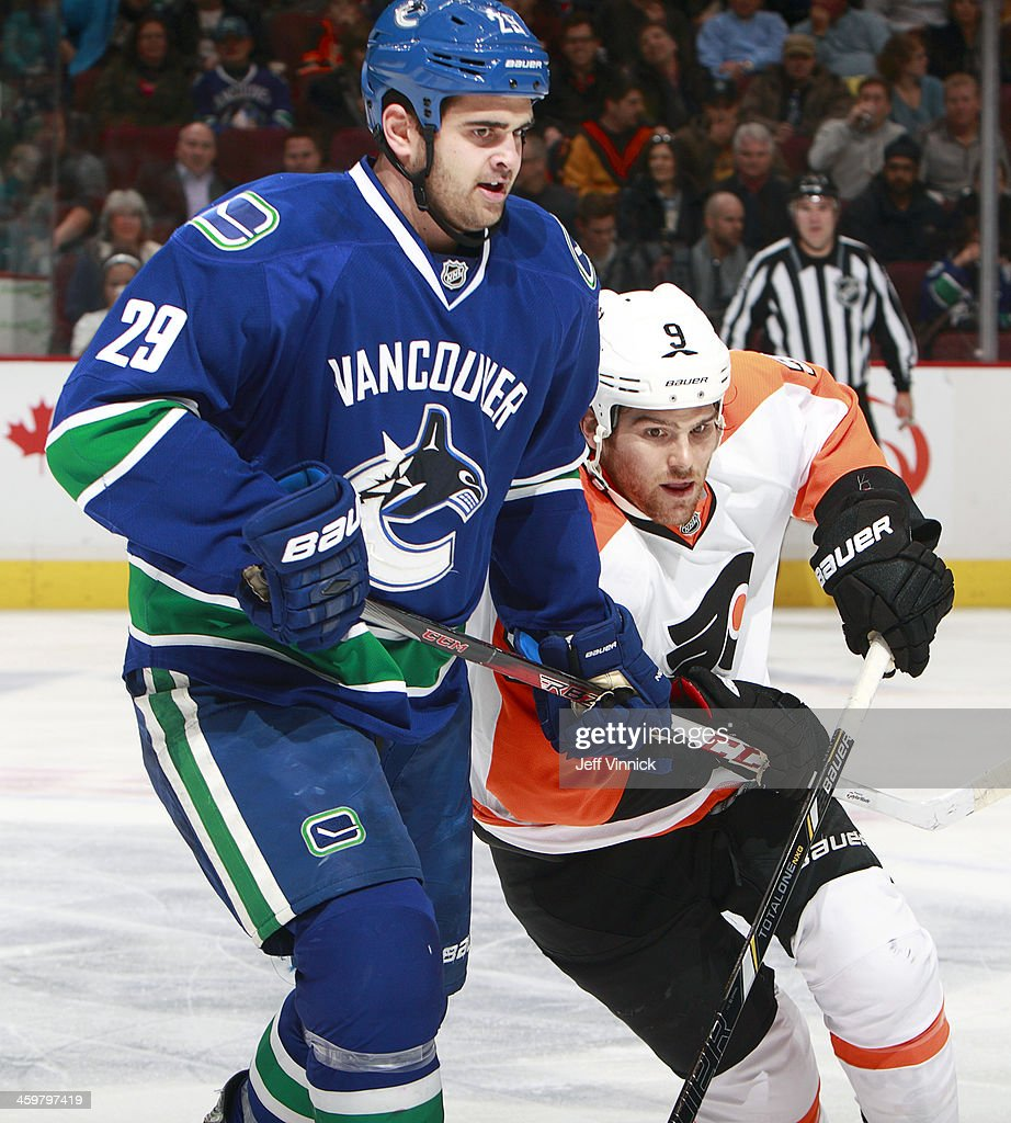Tom Sestito #29 of the Vancouver Canucks and Steve Downie #9 of the Philadelphia Flyers battle for position during their NHL game at Rogers Arena December 30, 2013 in Vancouver, British Columbia, Canada.