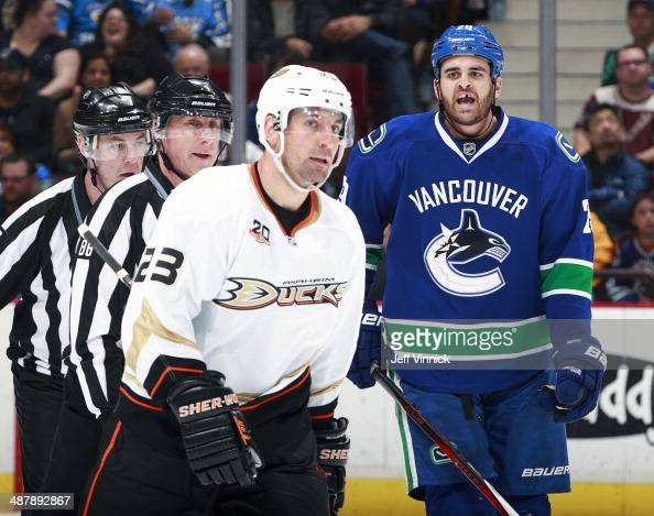 Tom Sestito of the Vancouver Canucks exchanges words with Francois Beauchemin of the Anaheim Ducks during their NHL game at Rogers Arena April 7 2014...