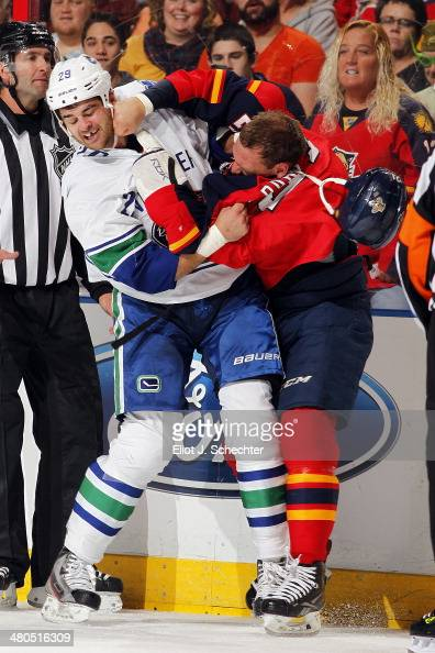 Tom Sestito of the Vancouver Canucks fights with Krys Barch of the Florida Panthers at the BBT Center on March 16 2014 in Sunrise Florida