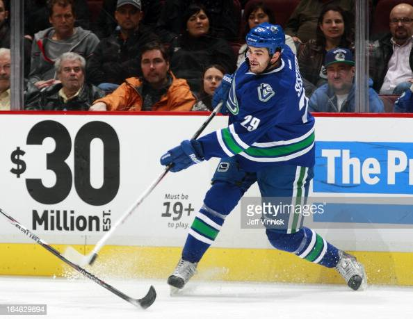 Tom Sestito of the Vancouver Canucks passes the puck up ice during an NHL game against the San Jose Sharks at Rogers Arena March 5 2013 in Vancouver...