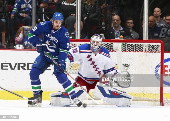 Tom Sestito of the Vancouver Canucks redirects a shot in front of Henrik Lundqvist of the New York Rangers during their NHL game at Rogers Arena...