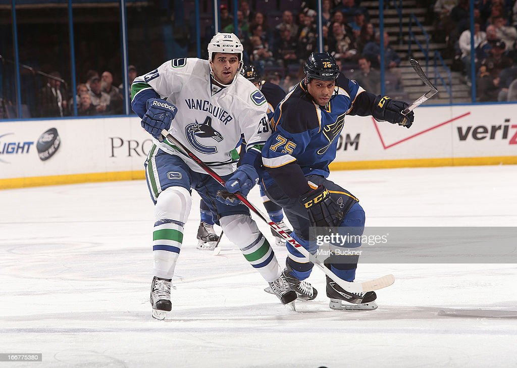 <a gi-track='captionPersonalityLinkClicked' href=/galleries/search?phrase=Tom+Sestito&family=editorial&specificpeople=4067117 ng-click='$event.stopPropagation()'>Tom Sestito</a> #29 of the Vancouver Canucks skates against <a gi-track='captionPersonalityLinkClicked' href=/galleries/search?phrase=Ryan+Reaves&family=editorial&specificpeople=4601052 ng-click='$event.stopPropagation()'>Ryan Reaves</a> #75 of the St. Louis Blues in an NHL game on April 16, 2013 at Scottrade Center in St. Louis, Missouri.