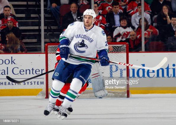 Tom Sestito of the Vancouver Canucks skates against the New Jersey Devils at the Prudential Center on October 24 2013 in Newark New Jersey The...