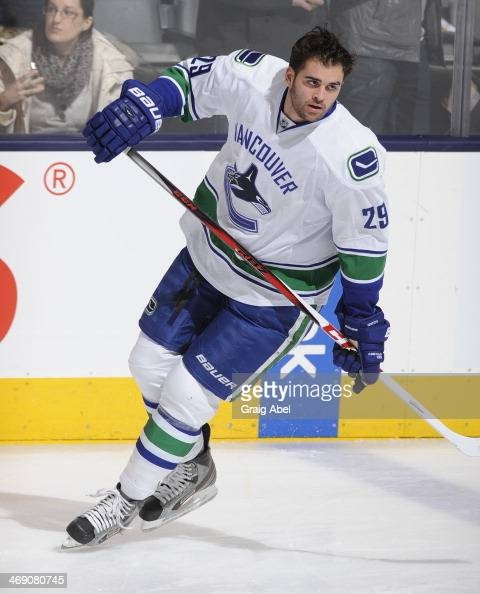 Tom Sestito of the Vancouver Canucks skates during warm up prior to NHL game action against the Toronto Maple Leafs February 8 2014 at the Air Canada...