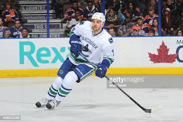 Tom Sestito of the Vancouver Canucks skates on the ice in a game against the Edmonton Oilers on November 1 2014 at Rexall Place in Edmonton Alberta...