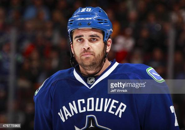 Tom Sestito of the Vancouver Canucks skates to the bench during their NHL game against the St Louis Blues at Rogers Arena February 26 2014 in...
