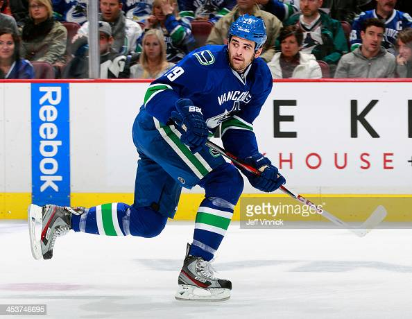 Tom Sestito of the Vancouver Canucks skates up ice during their NHL game against the Columbus Blue Jackets at Rogers Arena on November 22 2013 in...