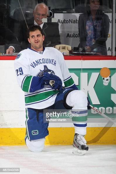 Tom Sestito of the Vancouver Canucks stretches prior to the game against the Colorado Avalanche at the Pepsi Center on March 27 2014 in Denver...