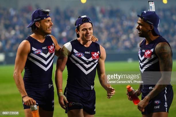 Tom Sheridan Lachie Neale and Bradley Hill of the Dockers are happy with the win during the 2017 AFL round 03 match between the Fremantle Dockers and...
