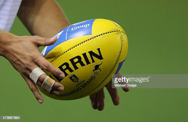 Tom Sheridan of the Dockers holds the ball with taped up fingers during the round seven AFL match between the Western Bulldogs and the Fremantle...