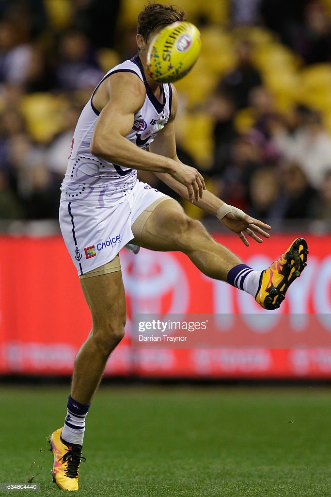 Tom Sheridan of the Dockers kicks the ball during the round 10 AFL match between the St Kilda Saints and the Fremantle Dockers at Etihad Stadium on May 28, 2016 in Melbourne, Australia.