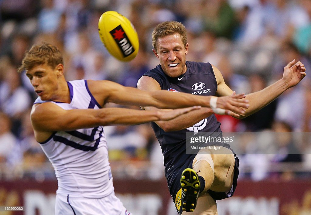 Tom Sheridan of the Fremantle Dockers spoils a kick from Jeremy Laidler of the Carlton Blues during the round two AFL NAB Cup match between the Carlton Blues and the Fremantle Dockers at Etihad Stadium on March 2, 2013 in Melbourne, Australia.