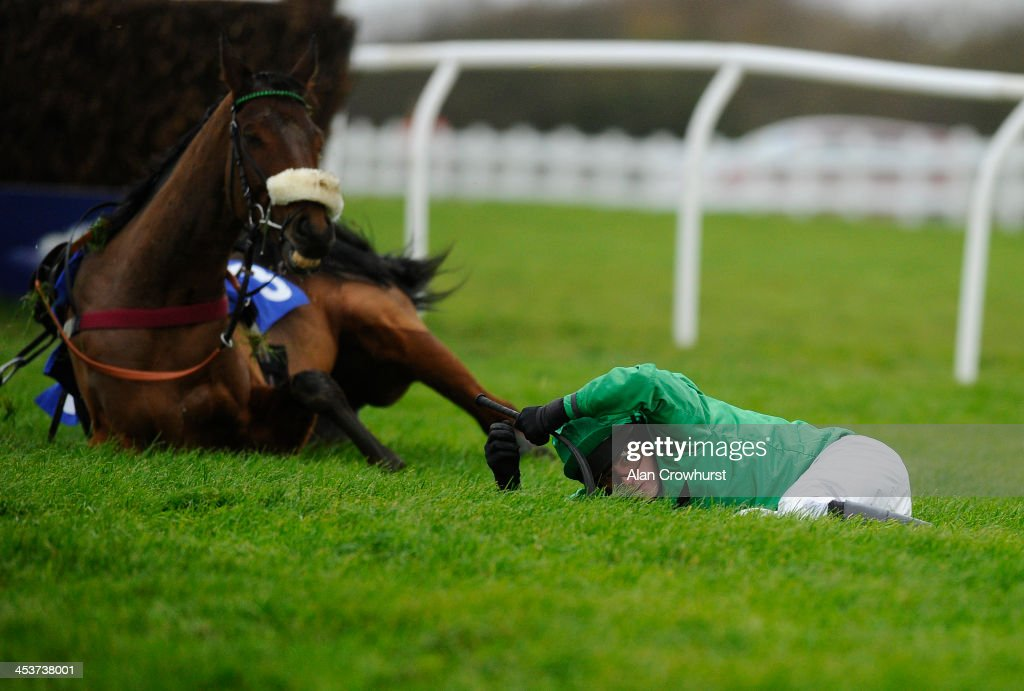 Tom Siddall falls from his mount Havingotascoobydoo in The Weatherbys hamilton Insurance Silver Buck Handicap Steeple Chase at Wincanton racecourse on December 05, 2013 in Wincanton, England.