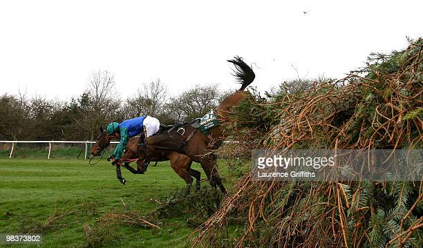 Tom Siddall parts company with Palypso De Creek during the John Smiths Grand National at Aintree Racecourse on April 10 2010 in Liverpool England