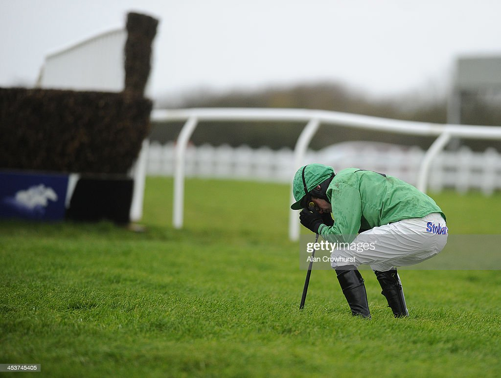Tom Siddall reacts after falling from his mount Havingotascoobydoo in The Weatherbys hamilton Insurance Silver Buck Handicap Steeple Chase at Wincanton racecourse on December 05, 2013 in Wincanton, England.