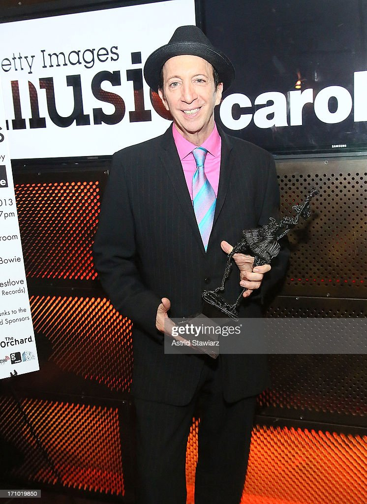 Tom Silverman, founder and CEO of Tommy Boy, poses for photos with the A2IM Lifetime Acheivement Award at the 2nd Annual Libera Awards at Highline Ballroom on June 20, 2013 in New York City.