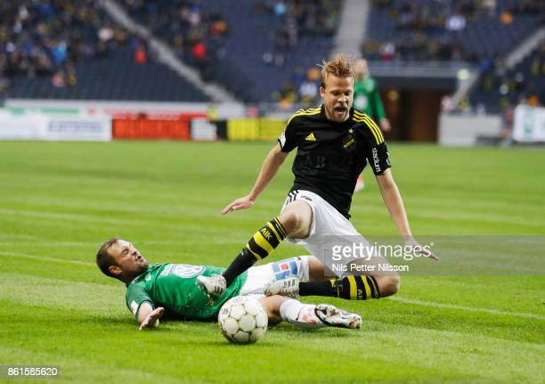 Tom Siwe of Jonkopings Sodra and Daniel Sundgren of AIK competes for the ball during the Allsvenskan match between AIK and Jonkopings Sodra IF at...