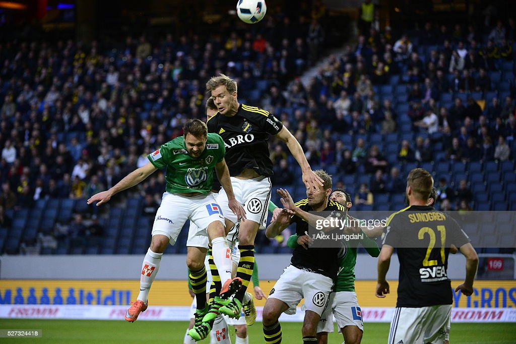 Tom Siwe of Jonkopings Sodra and Per Karlsson of AIK competes for the ball during the allsvenskan match between AIK and Jonkkoping Sodra IF at Friends arena on May 2, 2016 in Solna, Sweden.