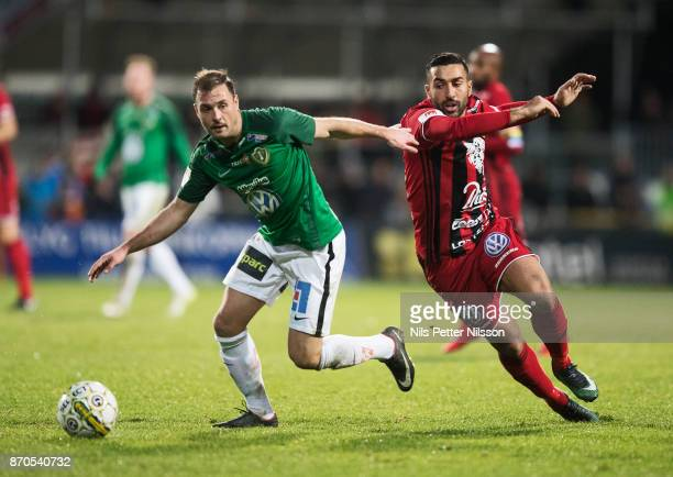 Tom Siwe of Jonkopings Sodra and Saman Ghoddos of Ostersunds FK competes for the ball during the Allsvenskan match between Jonkopings Sodra IF and...