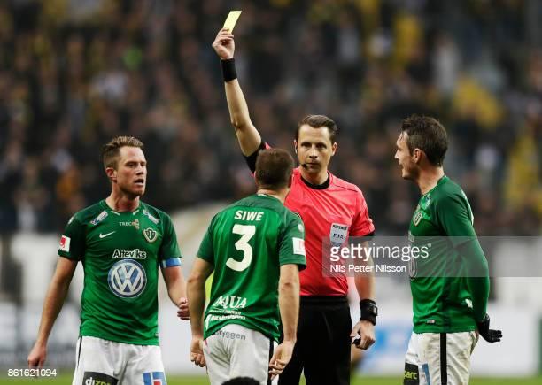 Tom Siwe of Jonkopings Sodra is being shown a yellow card by Andreas Ekberg referee during the Allsvenskan match between AIK and Jonkopings Sodra IF...