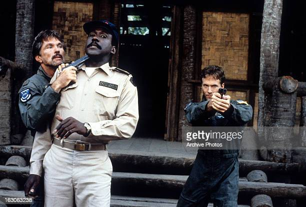 Tom Skerritt points a gun at Richard Roundtree in a scene from the film 'Opposing Force' 1986