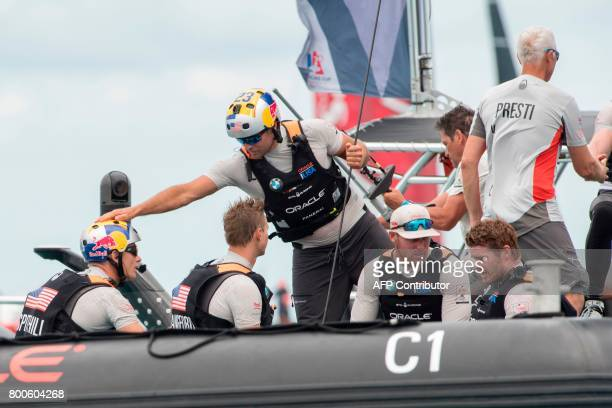 Tom Slingsby gives Jimmy Spithill a pat on the helmet after Oracle Team USA beat Emirates Team New Zealand in race six of the 35th America's Cup on...