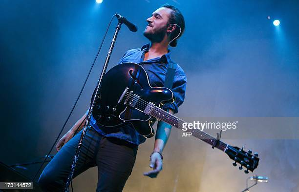 Tom Smith frontman of British indie rock band Editors performs on stage at the Westergasfasbriek in Amsterdam on July 8 2013 AFP PHOTO/ANP/ PAUL...