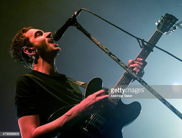 Tom Smith of Editors performs on stage at the Roundhouse on March 19 2014 in London England