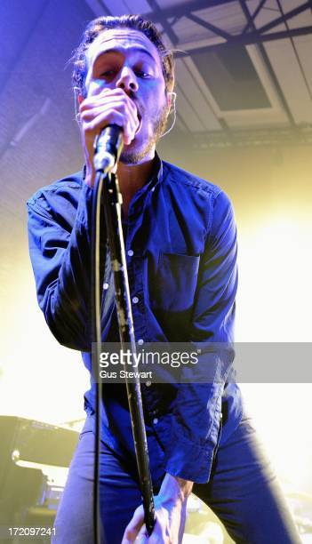 Tom Smith of Editors performs on stage at Village Underground on July 1 2013 in London England