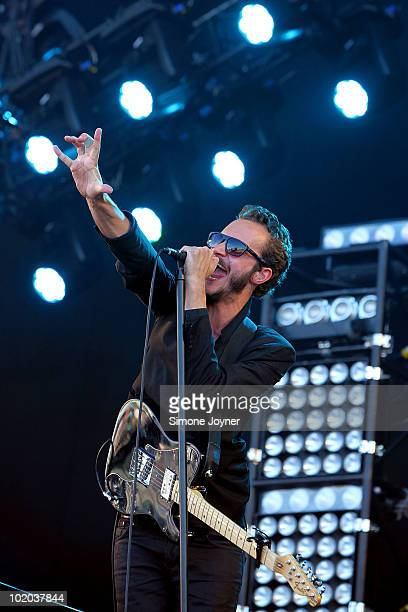 Tom Smith of Editors performs on the main stage during day three of the Isle of Wight Festival 2010 at Seaclose Park on June 13 2010 in Newport Isle...