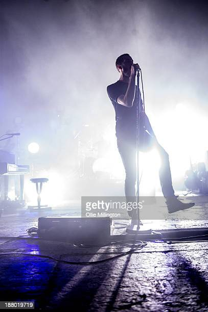 Tom Smith of Editors performs onstage during the band's November 2013 UK tour at Brixton Academy on November 14 2013 in London England