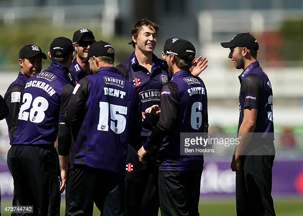 Tom Smith of Gloucestershire celebrates with team mates after dismissing Luke Wright of Sussex during the Natwest T20 blast match between Sussex and...