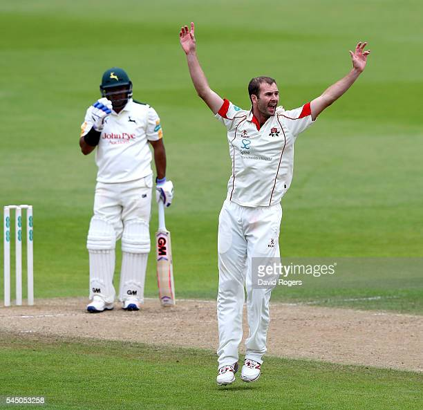 Tom Smith of Lancashire celebrates after taking the wicket of Samit Patel during the Specsavers County Championship division one match between...