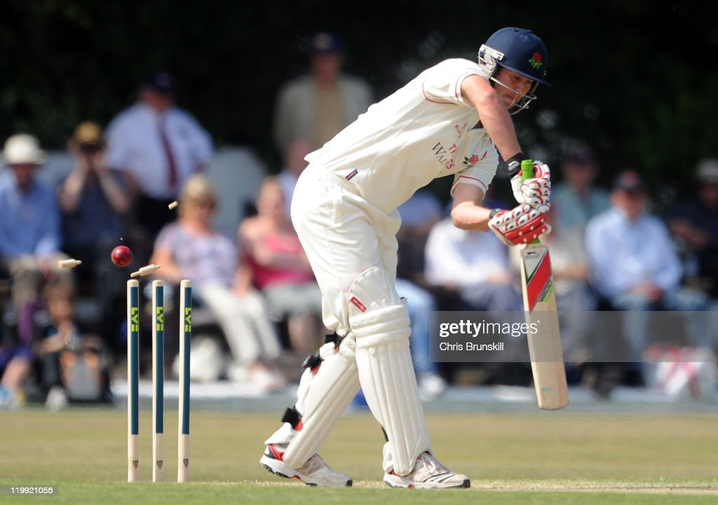 Tom Smith of Lancashire is bowled by Andre Adams of Nottinghamshire during the LV County Championship match between Lancashire and Nottinghamshire at...