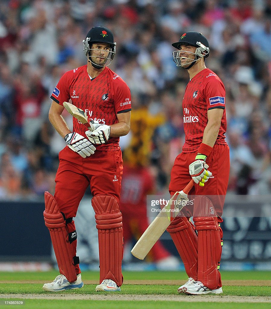 Tom Smith (L) of Lancashire Lightning and team-mate Stephen Moore look on during the Friends Life T20 match between Lancashire Lightning and Yorkshire Carnegie at Old Trafford on July 24, 2013 in Manchester, England.