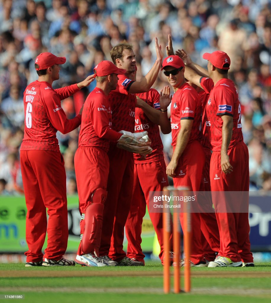 Tom Smith (C) of Lancashire Lightning is congratulated by his team-mates after taking the wicket of Joe Sayers of Yorkshire Carnegie during the Friends Life T20 match between Lancashire Lightning and Yorkshire Carnegie at Old Trafford on July 24, 2013 in Manchester, England.
