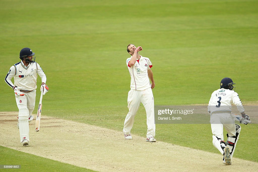 <a gi-track='captionPersonalityLinkClicked' href=/galleries/search?phrase=Tom+Smith+-+Cricket+Player&family=editorial&specificpeople=4180561 ng-click='$event.stopPropagation()'>Tom Smith</a> of Lancashire shows frustration as <a gi-track='captionPersonalityLinkClicked' href=/galleries/search?phrase=Adil+Rashid&family=editorial&specificpeople=870228 ng-click='$event.stopPropagation()'>Adil Rashid</a> (R) of yorkshire hits a boundary during day three of the Specsavers County Championship: Division One match between Yorkshire and Lancashire at Headingley on May 31, 2016 in Leeds, England.