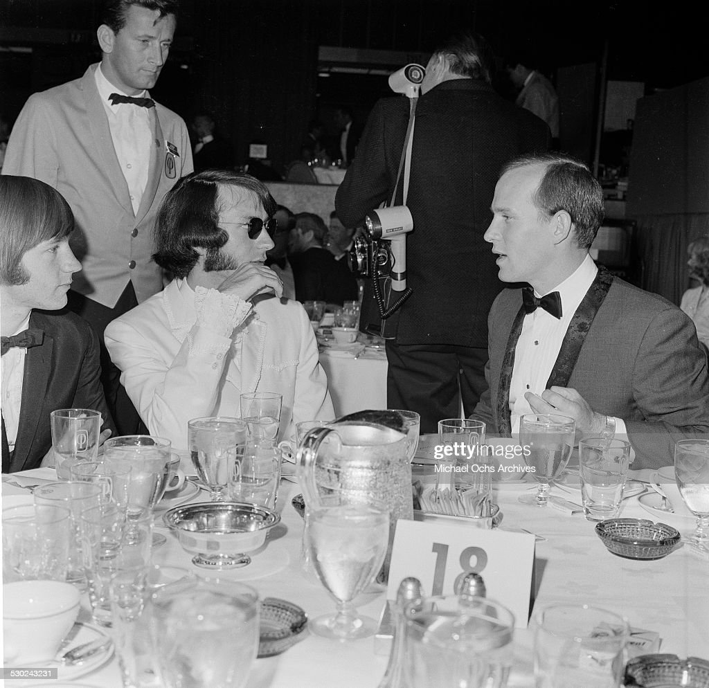 Tom Smothers talks with Michael Nesmith and Peter Tork of 'The Monkees' the Emmy Awards in Los AngelesCA
