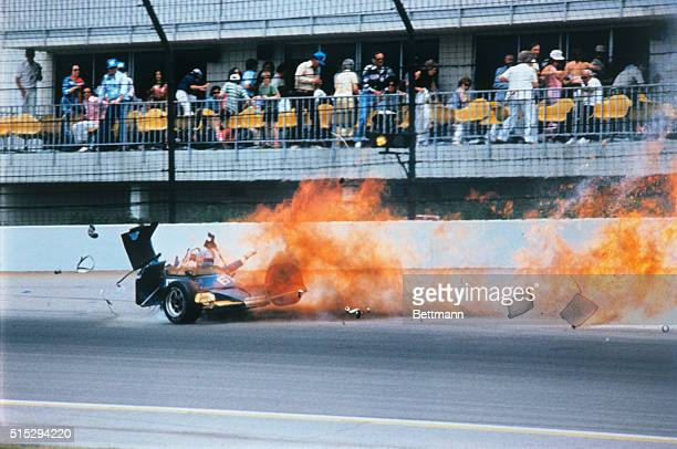 Tom Sneva's NortonMcLaren racer flies through the air trailing flame and debris after a 170mph crash on the second turn of the Speedway in 5/25 race...